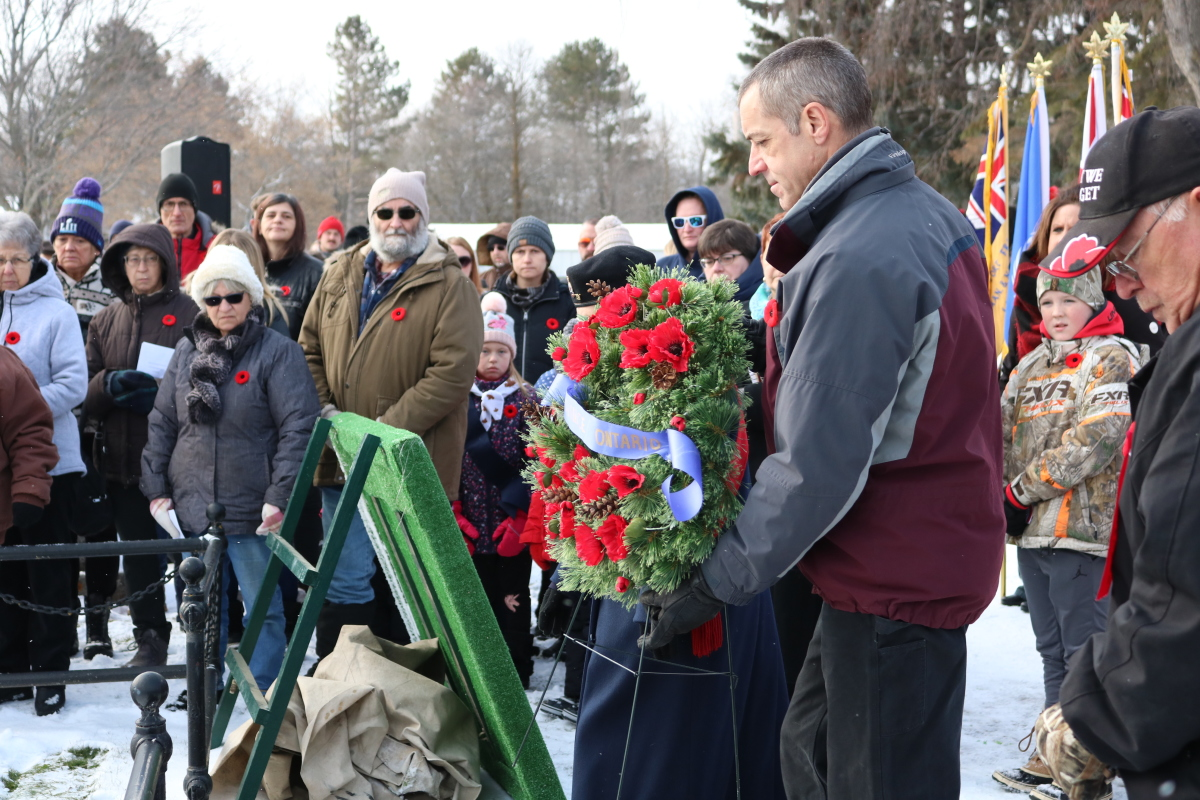 carrying wreath