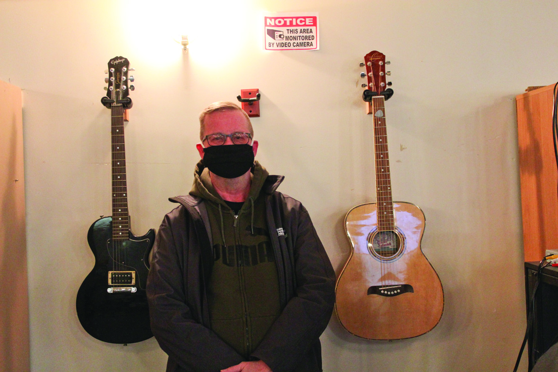 Donated guitars bring warmth of music to Out of the Cold