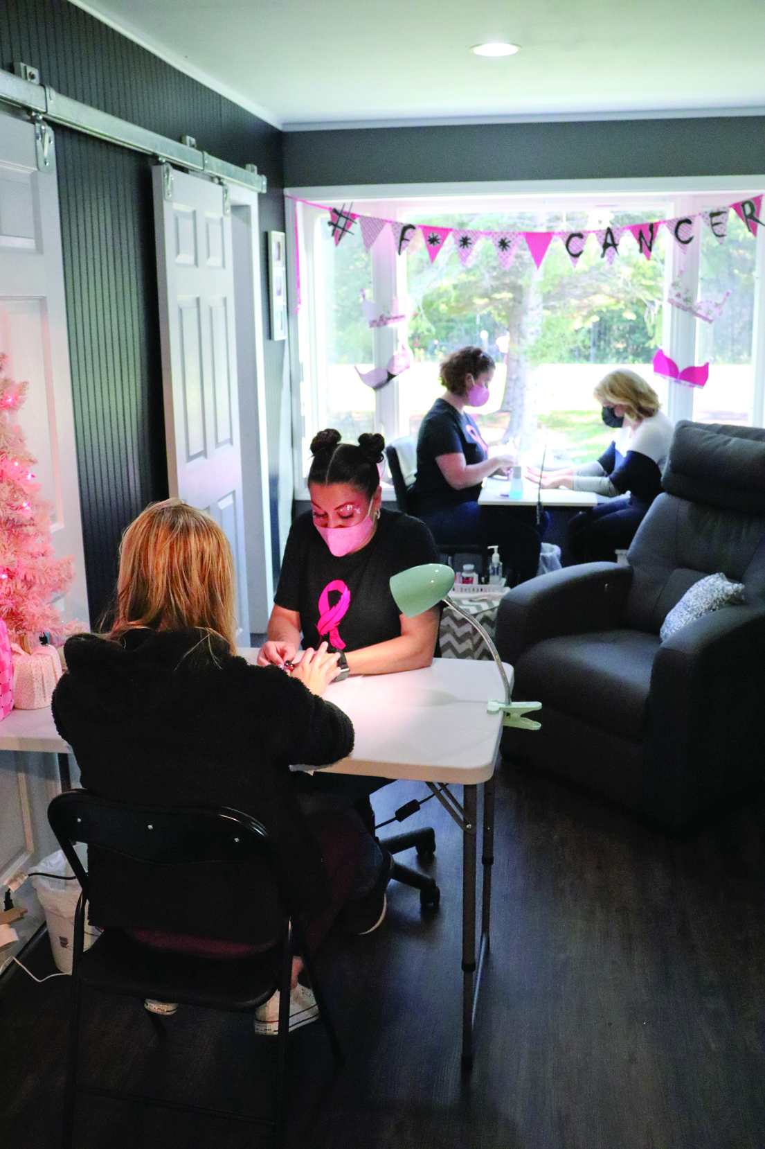 """Estheticians hold """"Pretty in Pink"""" manicure day for breast cancer research"""
